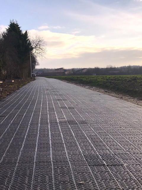 Green power on grey asphalt